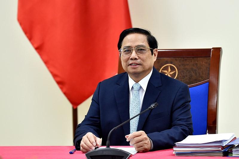 Thủ tướng Phạm Minh Chính họp trực tuyến với bà Aurélia Nguyen, Giám đốc điều hành Chương trình COVAX. (Nguồn: Cổng TTĐT Chính phủ)