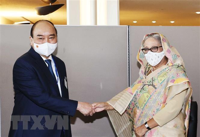 Chủ tịch nước Nguyễn Xuân Phúc gặp Thủ tướng Bangladesh Sheikh Hasina. (Ảnh: Thống Nhất/TTXVN)